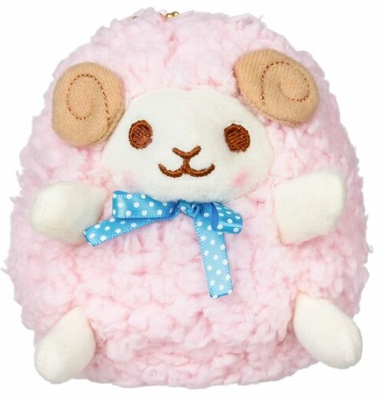 A Pink Sheep Keychain with brown eyes, pink wool and wearing a blue polk-a-dot bow.
