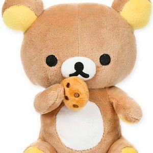 Rilakkuma bear with round dark eyes and a white tummy, eating a chocolate chip cookie.